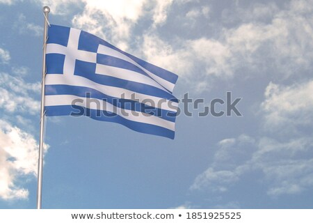 Flag of Greece waving on a cloudy sky. Stock photo © Photooiasson