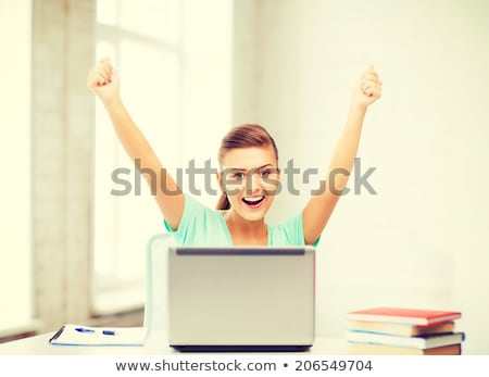 happy student girl with book and notebook at home stock photo © dolgachov