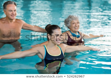 çift egzersiz yüzme havuzu sualtı atış Stok fotoğraf © Kzenon