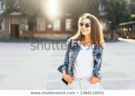 Csinos mosolyog barna hajú pózol fekete póló Stock fotó © acidgrey