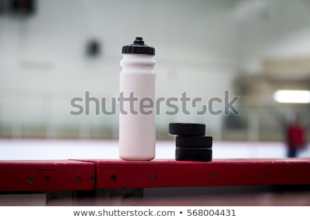 ice hockey rink, bottle on board Stock photo © fotoduki