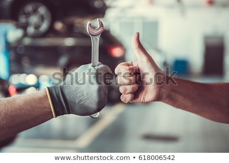 Car Mechanic Holding Spanner Stock photo © AndreyPopov