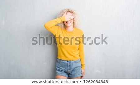 smiling young woman over dark grey grunge background stock photo © doodko