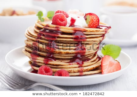 Pancakes with jam and berries Stock photo © AGfoto