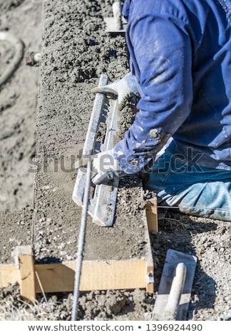 piscine · travailleur · de · la · construction · travail · tige · humide · concrètes - photo stock © feverpitch