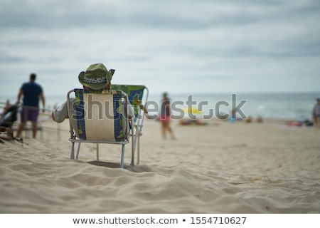Man Relaxing on Vacation, Male on Beach Summer Stock photo © robuart