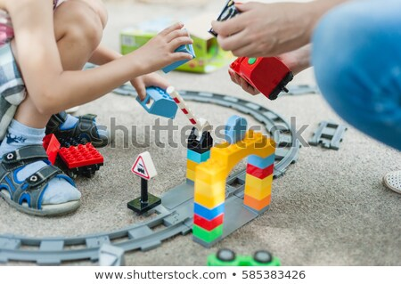The child collects the Designer. Kids activity in kindergarten or at home. A boy plays in big design Stock photo © galitskaya