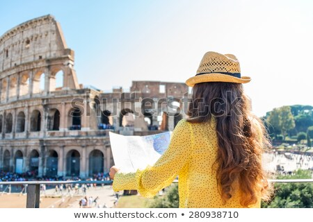 Woman Looking At Colosseum Stock photo © AndreyPopov