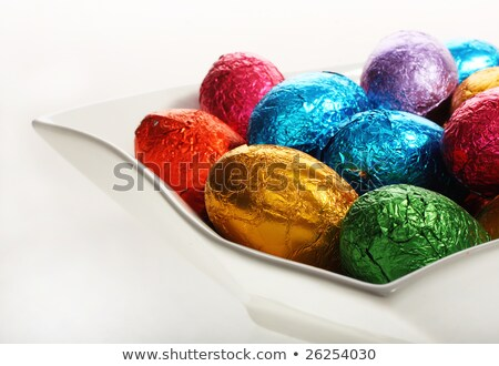 close up of chocolate eggs and candies on plate Stock photo © dolgachov