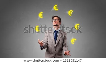 Person juggle with euro symbol Stock photo © ra2studio