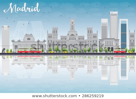 Madrid Skyline with grey buildings, blue sky and reflections. Stock photo © ShustrikS