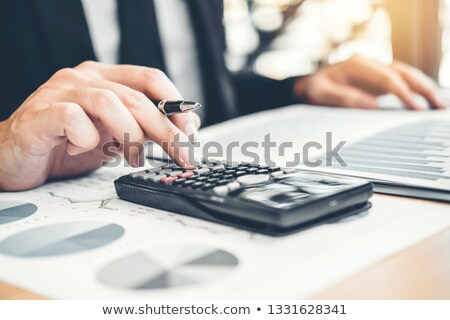 Man Calculating Savings And Costs Stock photo © AndreyPopov