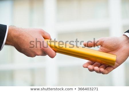 Person Passing Baton To Businessman Stock photo © AndreyPopov