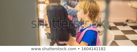 boy hairdresser, day of choice of profession, play at the hairdresser in the children's beauty salon Stock photo © galitskaya
