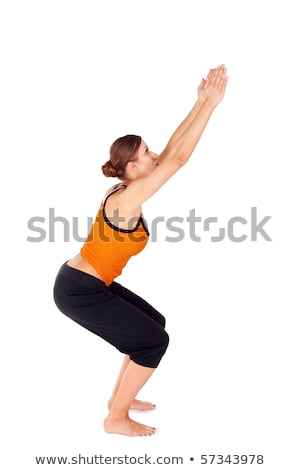 Woman Practicing Yoga Exercise Called Chair Pose Stock photo © rognar