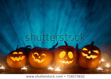 Stock photo: halloween pumpkins with ray background