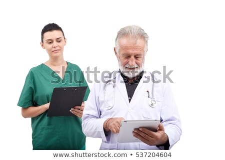 Doctor reviewing a patient's records Stock photo © photography33