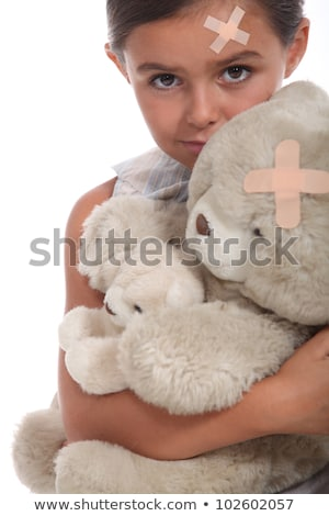 Girl and teddy with a plaster on forehead Stock photo © photography33