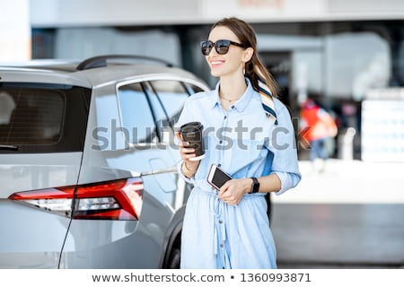 Stok fotoğraf: Içme · benzin · güzel · bir · kadın · benzin · can · konteyner