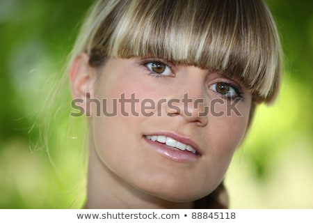 Girl with a blunt fringe outdoors Stock photo © photography33