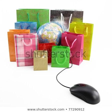 world globe with shopping bags stock photo © gladiolus