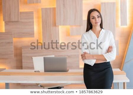 Nő áll keresztbe tett kar visel fekete ruha szexi Stock fotó © wavebreak_media