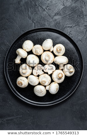 Brown and white champignons Stock photo © elxeneize