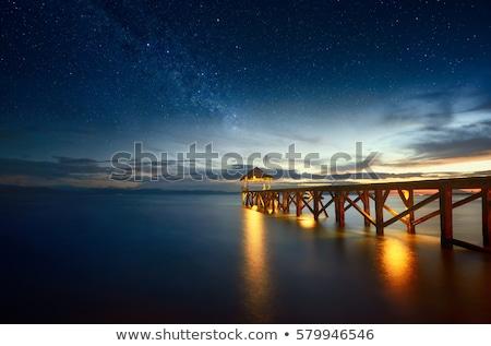 napfelkelte · fából · készült · móló · tó · víz · fa - stock fotó © kawing921