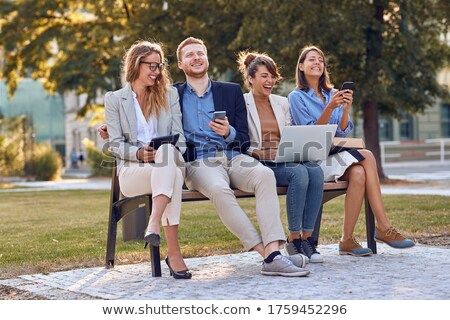 casual group of people reading good news on their tablet Stock photo © feedough