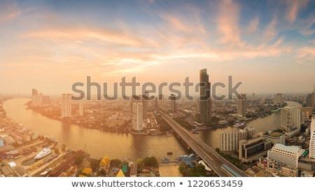 Skyline rivier Bangkok wolkenkrabber zonsondergang Stockfoto © meinzahn