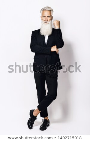 Handsome well-dressed man in jacket with beard and mustache  Stock photo © Nejron