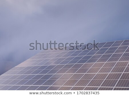 Solar panel power station on cloudy day Stock photo © backyardproductions