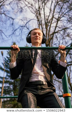 Young businessman to hang himself with tie Stock photo © deandrobot