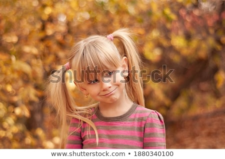 Portrait of a blond cutie Stock photo © konradbak