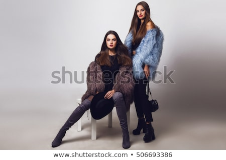Elegant woman in fur and sunglasses. Stock photo © NeonShot