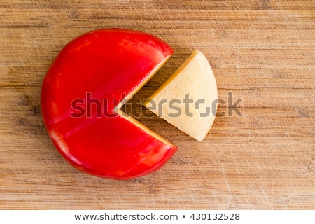 Wheel of fresh gouda cheese with a red rind Stock photo © ozgur