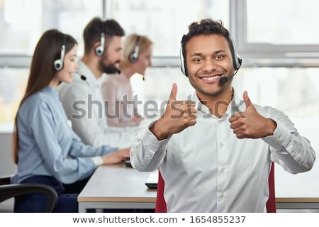 Foto stock: Businessman Shows Approval Represents Thumb Up And Approved
