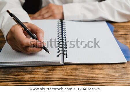 Notepad her ballpoint pen, on white background. Stock photo © justinb