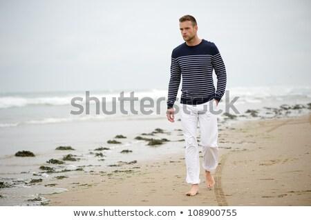 young man walking by the seashore Stock photo © nito