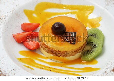 Round Sweet Cupcake with White and Orange Cream Stock photo © robuart