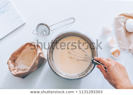 Woman whisking batter in a bowl Stock photo © wavebreak_media