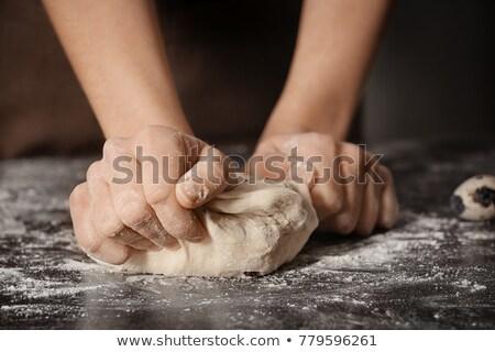Woman kneading dough with chocolate chips Stock photo © wavebreak_media