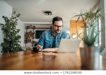 portrait of male with laptop stock photo © is2