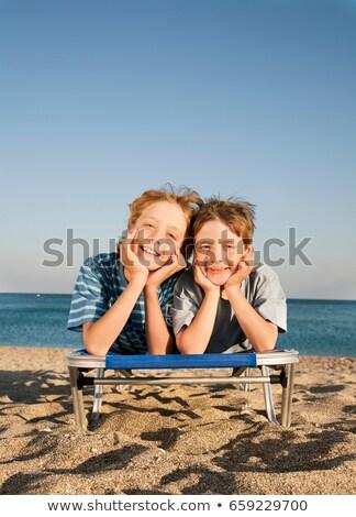 два мальчики солнце пляж весело мальчика Сток-фото © IS2