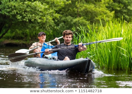 two men with oars and a raft on a beach stock photo © is2
