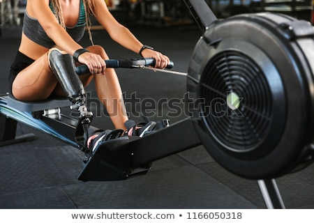 Cropped photo of handicapped sportswoman in tracksuit working ou Stock photo © deandrobot