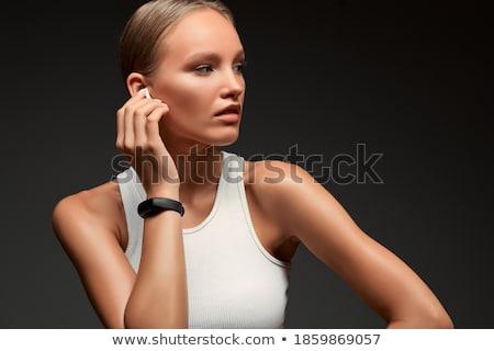 фитнес улыбающаяся женщина глядя прослушивании музыку Сток-фото © deandrobot