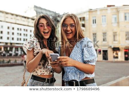 Dois preto jeans posando cadeias Foto stock © acidgrey