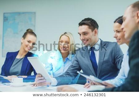 üzletember átlátszó tabletta Föld üzlet valóság Stock fotó © dolgachov