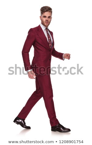 side view of young businessman with parted lips walking Stock photo © feedough